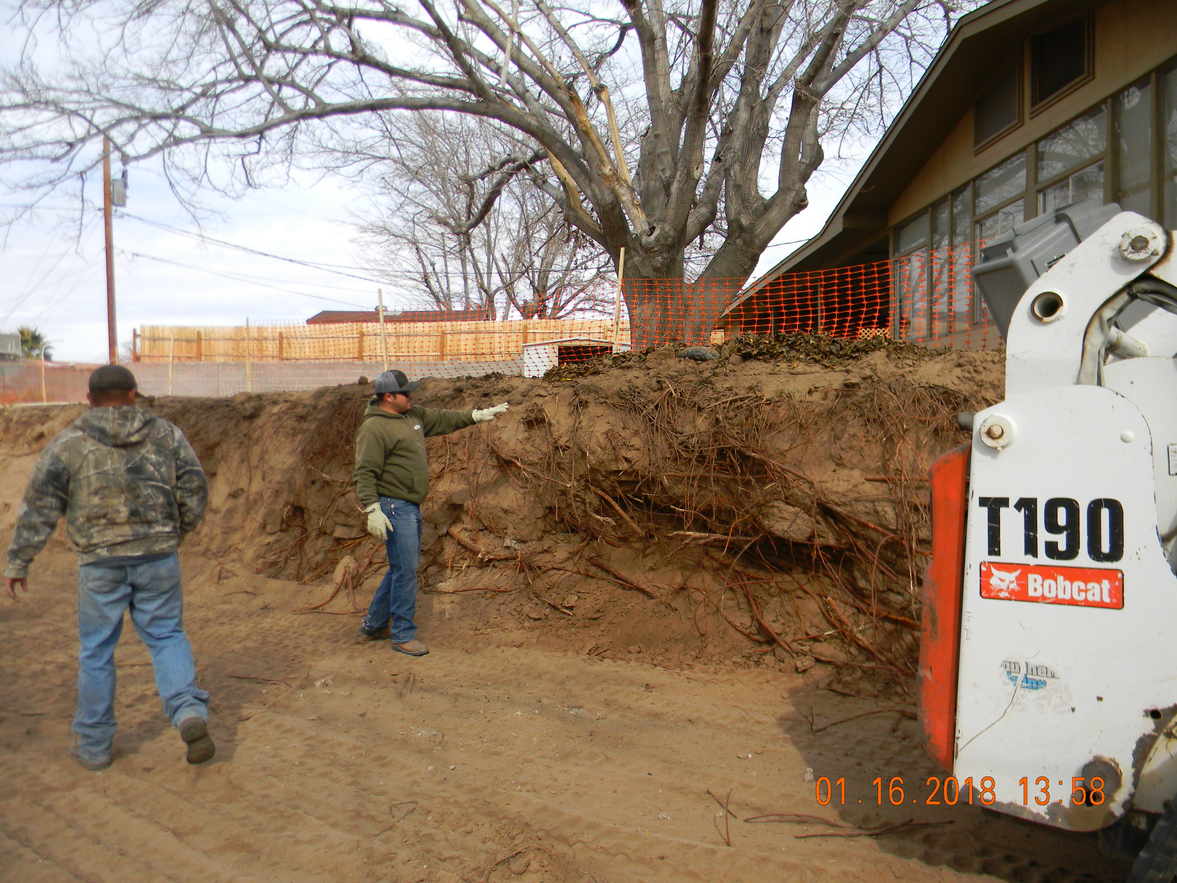 Demolition Men Working On Retaining Wall